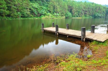 Wood Dock in Serene Lake Stock Photo