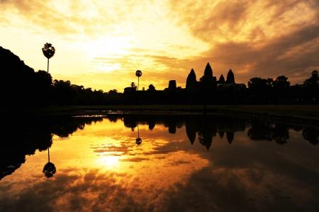 angkor wat: Angkor Wat Temple at Silhouette Sunrise Stock Photo