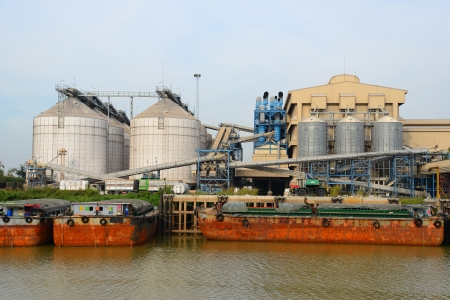 Industrial Refinery by the River  Stock Photo
