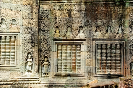 thom: Wall of Temple in Angkor Thom, Cambodia Stock Photo