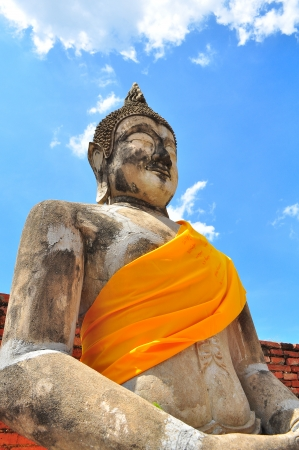 Ancient Ruin Stone Buddha Statue in Ayutthaya Province, Thailand photo