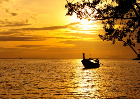Sea Sunrise and Long Tail Boat photo