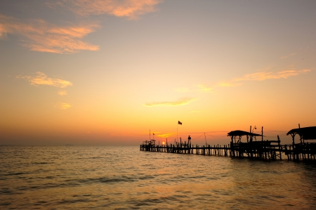 Wood Dock in the Sea at Morning Sunrise photo