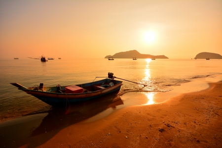 Long Tail Boat at Sunrise Beach Stock Photo