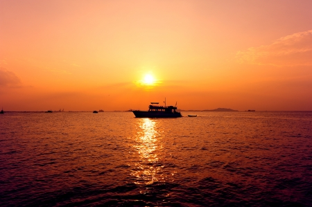 Sea Sunset and Boat photo