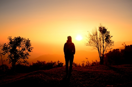 Lonely Girl on Mountain Sunrise