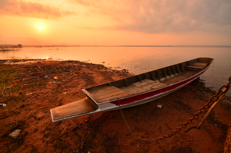 Small Fishing Boat at Sunrise Lake photo
