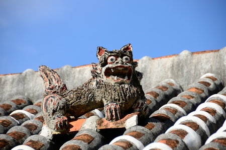 goodluck: Old house roof Shisa Stock Photo