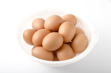 browns: egg, eggs, sieve Stock Photo