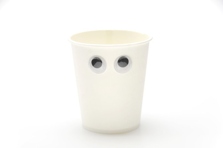 small articles: paper cup, eyeball, look around restlessly