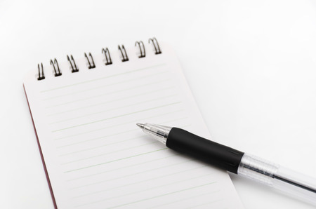 small articles: Notepad and ballpoint pen Stock Photo