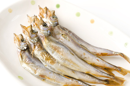 lanceolatus: Japanese food Shishamo, Grilled fish capelin on plate Stock Photo