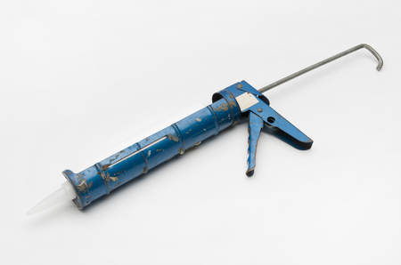 Used tools Caulking gun, Stock Photo