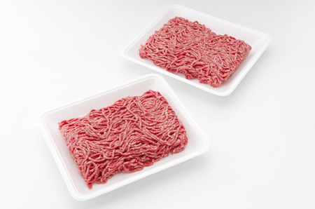 polystyrene: Raw beef minced meat in a white polystyrene tray isolated on a white background.