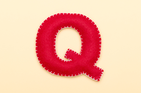 Red felt Q Stock Photo