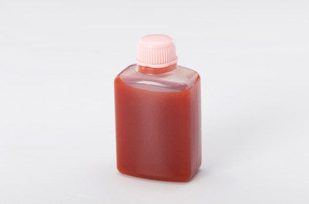 Small plastic bottle with ketchup for take-away Stock Photo