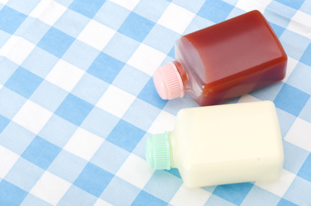 Small plastic bottle Mayonnaise and ketchup