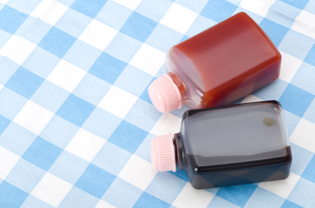 Small plastic bottle Soy sauce and ketchup Stock Photo
