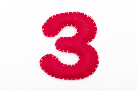Red felt numeral 3