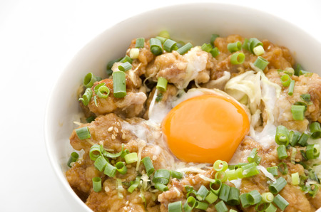 Japanese food, Toritendon, chicken tempura with egg in a rice in bowl isolated on white background