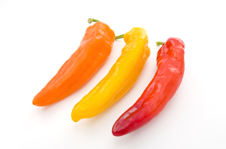 Three Palermo sweet peppers isolated on white background.