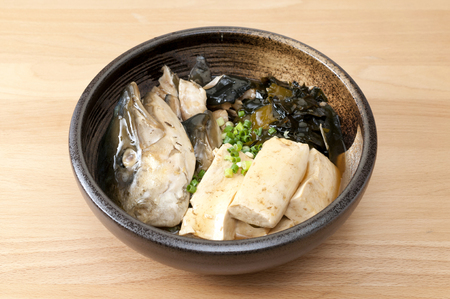 Japanese cuisine and Simmered Yellowtail (Japanese Amberjack) with tofu 스톡 콘텐츠
