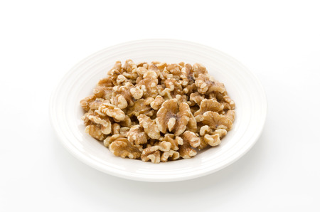 walnut on a dishes Foto de archivo - 95712061