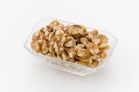 Walnut in a Glass dishes Foto de archivo - 95798177