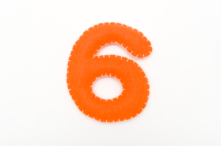 Orange color felt numeral 6