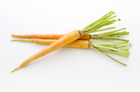 shimaninjin, a type of yellow carrot grown in Okinawa, yellow carrot on white background