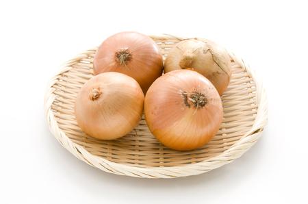 yellow onion in bamboo sieve