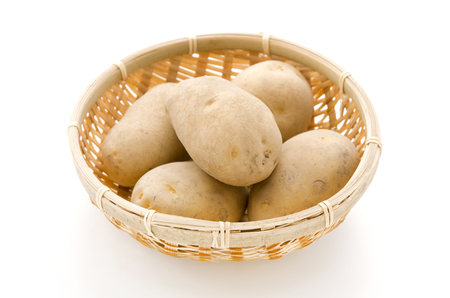 potatoes in bamboo sieve