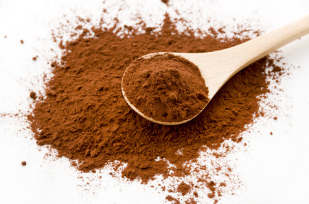 cocoa powder and wooden spoon Stock Photo