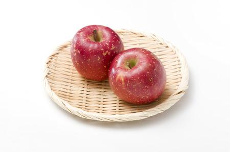 fresh apple on a bamboo sieve Stock Photo