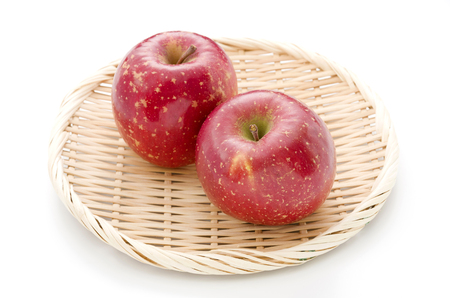 SUN Fuji fresh apple on a bamboo sieve Stock Photo