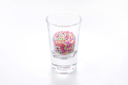 Colorful sprinkles sugar in glass 写真素材