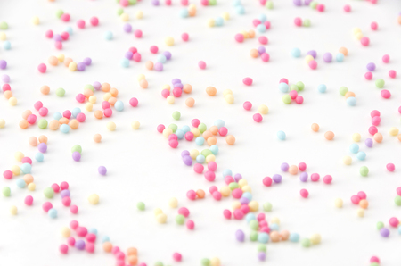 Colored sprinkles, decoration for cake and bekery, Colored sprinkles white background,