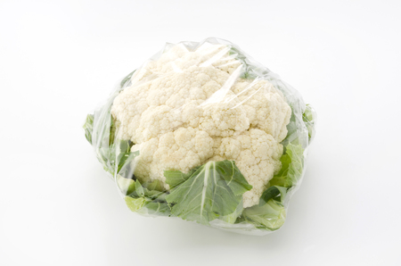 Fresh cauliflower in plastic bag Stock fotó