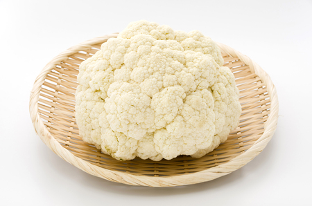 Fresh cauliflower on bamboo sieve
