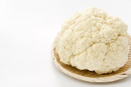 Fresh cauliflower on bamboo sieve