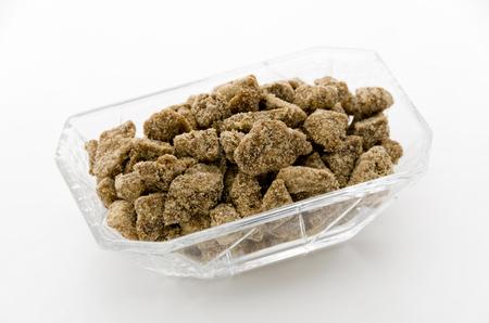 brown sugar in small square glass bowl Stock Photo