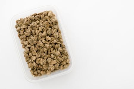 brown sugar in rectangular plastic container Stock Photo