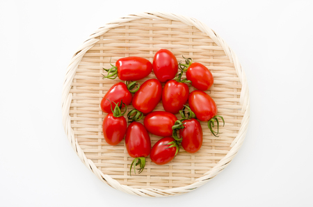 Fresh cherry tomatoes on bamboo sieve 스톡 콘텐츠