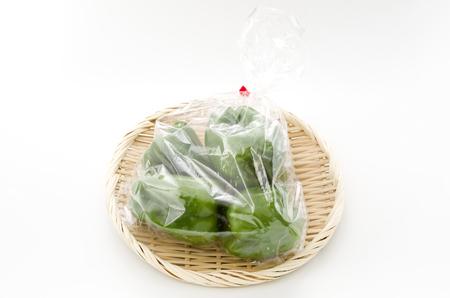 bell pepper in plastic bag on bamboo sieve Stock Photo