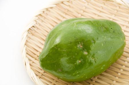Green Papaya on a bamboo sieve. Stock Photo