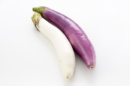 Long thin white eggplant and Long thin Purple eggplant isolated white background Stock Photo