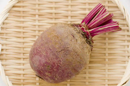 Red beet or beetroot on bamboo sieve.