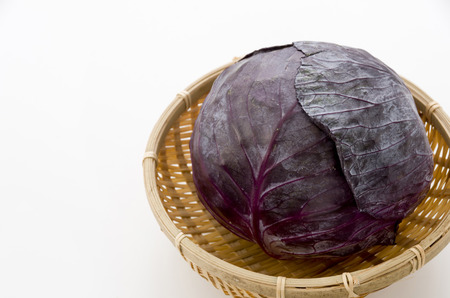 purple cabbage on bamboo sieve.
