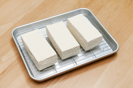 firm tofu on cooking aluminum tray