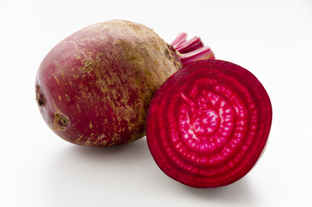 Isolated beet. Whole red beetroot and a half isolated on white background. Stockfoto